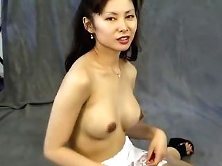 Sexy Asian Cougar With Big Tits Maya Chung Thumbs Her Taut Peach