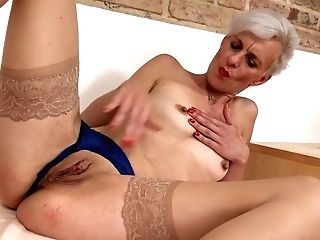 Lusty, Blonde Cougar Is Playing With Her Tits And Coochie, While We Get To Witness Her